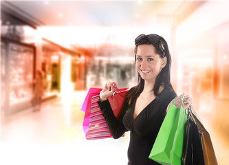 Shopping young woman in the shopping mall.