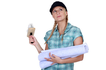 Woman deciding on color of wallpaper