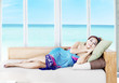 Asian woman taking a nap by the beach