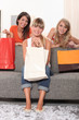 Three woman holding shopping bags