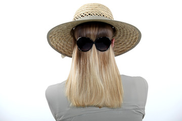 Woman wearing sunglasses backwards