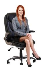 happy redhead woman sitting on chair