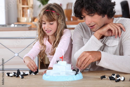 Child playing with her father