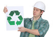 Curious worker holding recycle logo