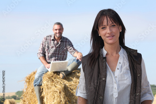happy couple relaxing in their farm