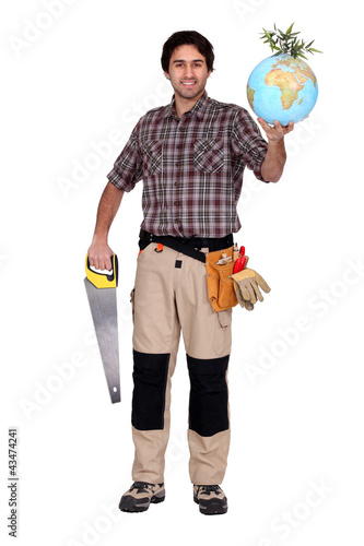 Man holding saw and globe