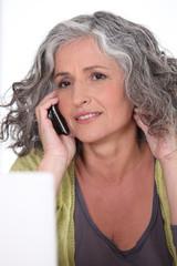 Senior lady making a call