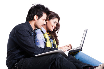 happy young couple using laptop isolated on white