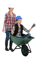 Young women laborers with a wheelbarrow
