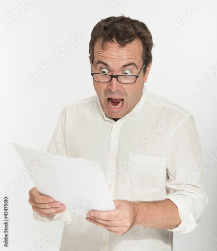 Scared man reading a document