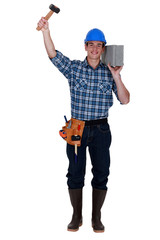 Builder with a block and hammer
