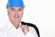 senior businessman wearing helmet and smiling