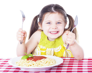 Beautiful girl eating pasta