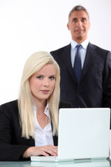 Man approaching from behind young blonde