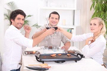 Friends having dinner at home