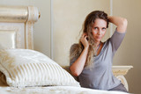 Beautiful woman in a bedroom
