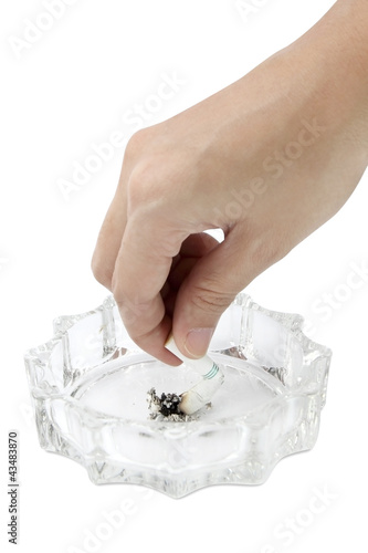 A woman s hand holding a cigarette - isolated on white