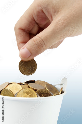 Increase your savings-Hand holding coins against