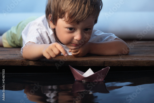 paper ship in children hand