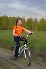 beauty girl o bicycle outdoors