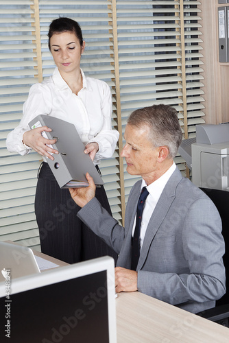 businessman takes the file