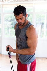 Handsome muscular man working out.