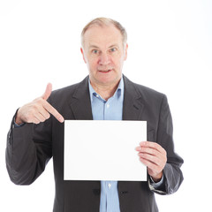 Middle-aged businessman pointing to a blank white card