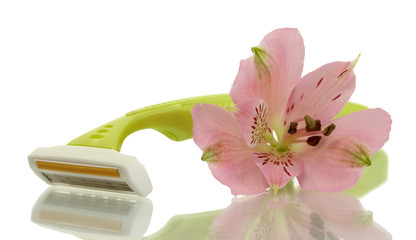woman safety shaver and flower isolated on white.