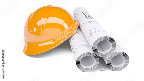 Rolls of architectural drawings and orange construction helmet