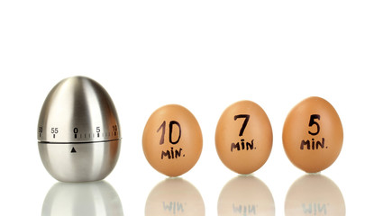egg timer and eggs isolated on white