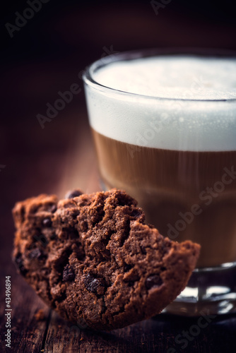 Chocolate chip cookie and a glass of cafe latte