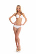 A young Caucasian woman posing in a white swimsuit