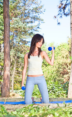Young woman doing  gym exercises in the park