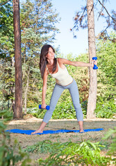 Young beautiful woman doing  exercises in the park