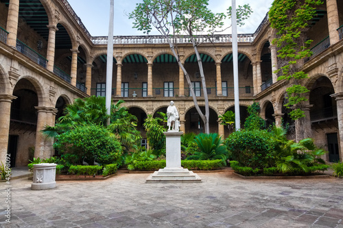 Spanish colonial palace in Old Havana with a statue of Columbus