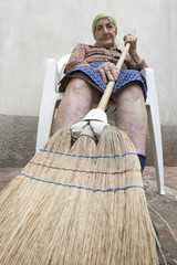 senior woman broom
