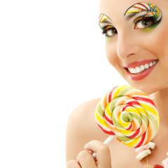 woman licks candy with beautiful make-up