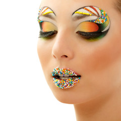studio beauty portrait of attractive woman with beautiful candy