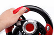 The hand on the steering wheel computer game consoles, isolated