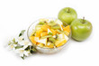 Fresh fruits salad an two apples on white background.