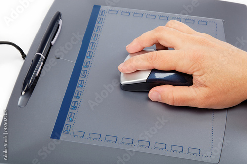 Hand on Tablet with Cordless Wheel Mouse and Pen isolated on whi