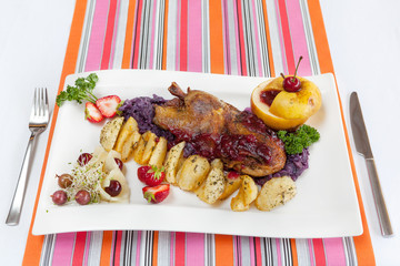 Roasted duck with potatoes and vegetables