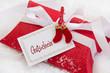 Ein Weihnachtsgutschein in Rot und Weiß