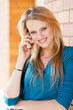 attractive happy young woman talking on mobile phone