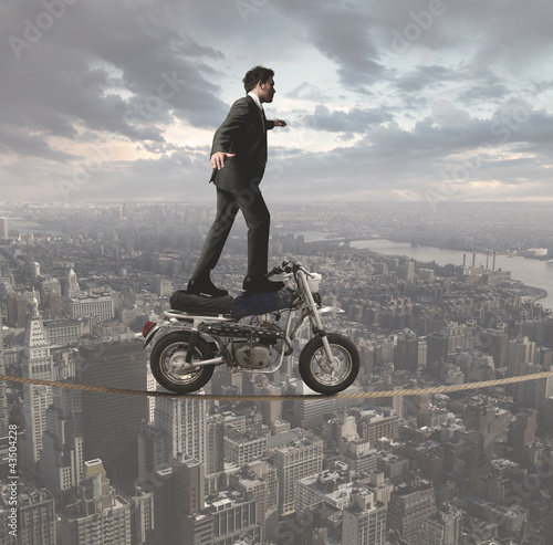 Businessman and acrobatic challenges