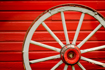 Wagon Wheel by Painted Red Wall