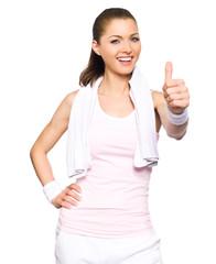 Sportliche Frau macht Topdaumen