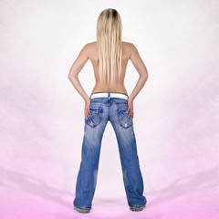 Sexy back of a blonde head woman wearing jeans