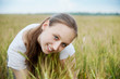 Beautiful woman smiles in field