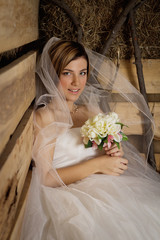portrait of a young bride in the hayloft